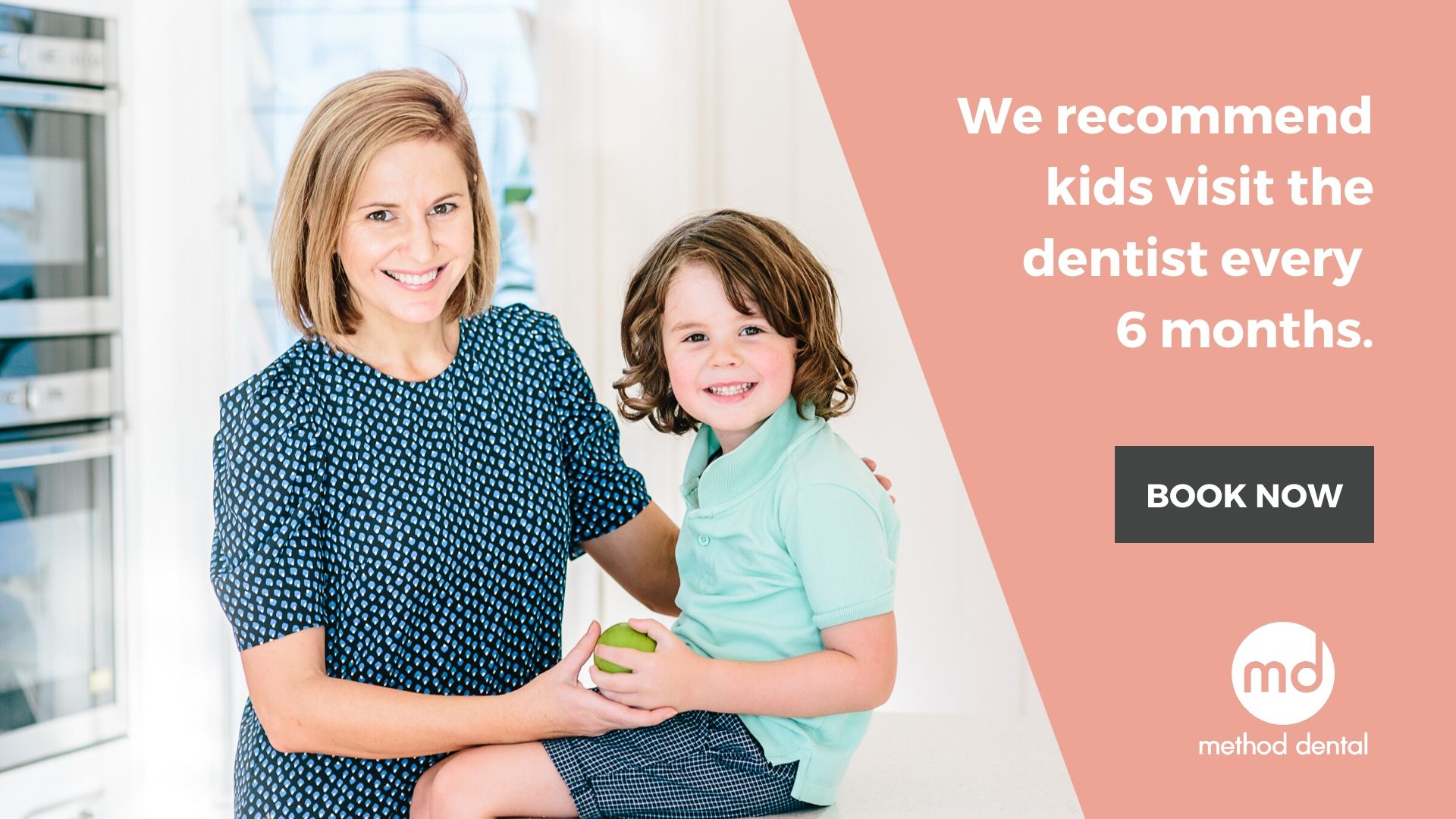 Mum and boy with apple recommending regular dental check ups for kids