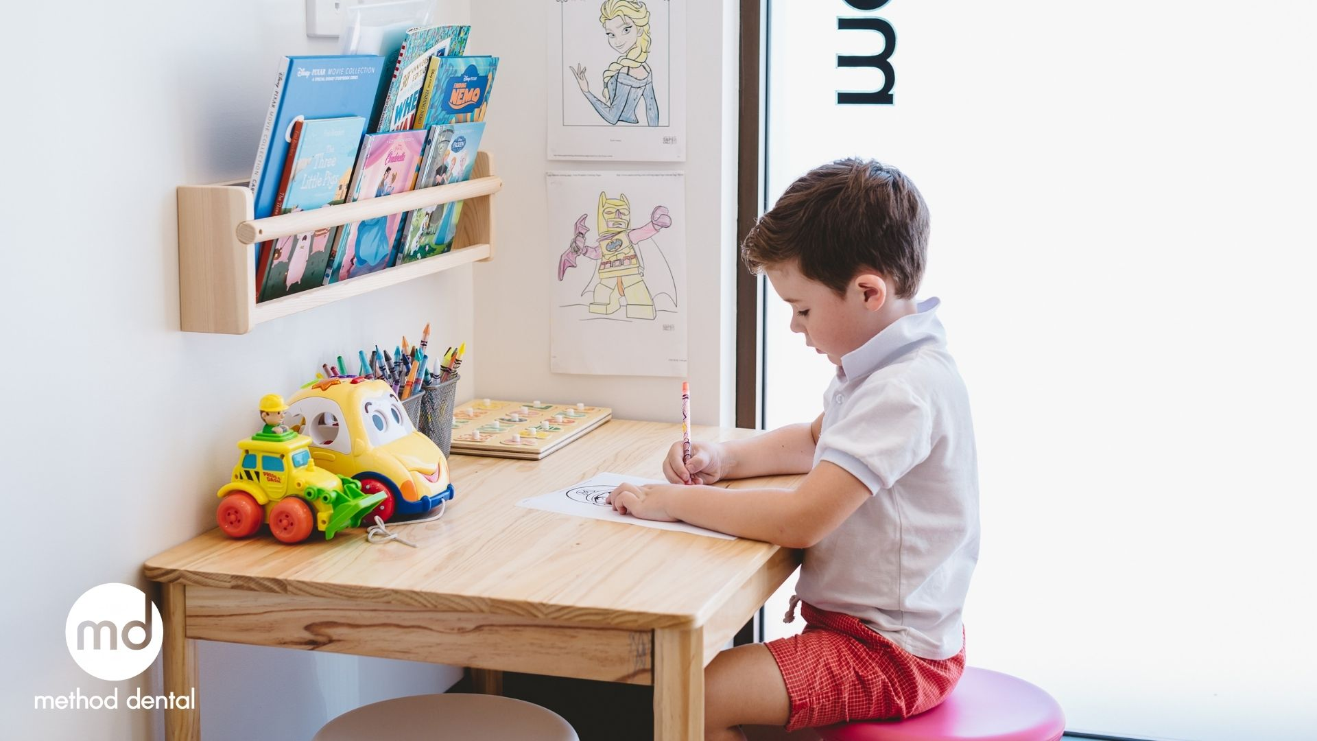 a child colouring in at method dental